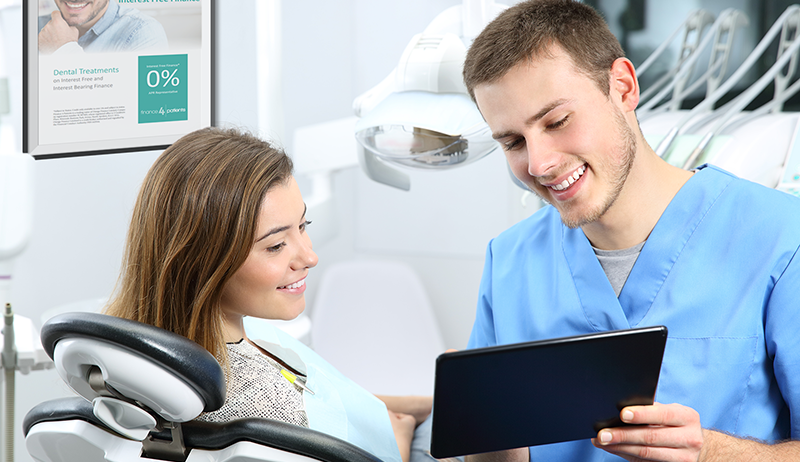 dentist showing patient finance